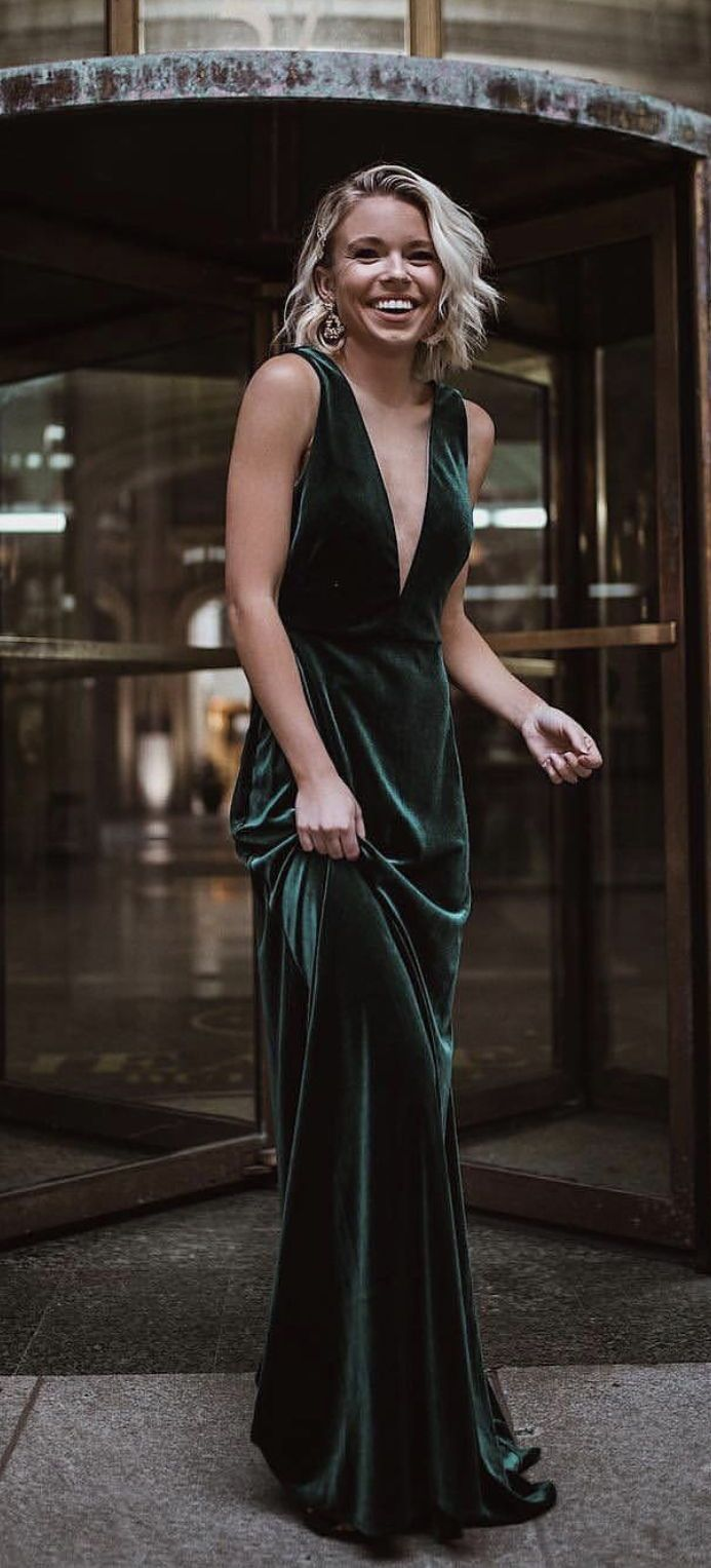 Luxe in Emerald Velvet by Jenny Yoo! The long Logan dress is a flattering soft A line silhouette with a chic plunging V neck in our luxurious & comfortable Stretch Velvet. Illusion tulle   at the neckline creates a fitted bodice while a deep V in the back flows   softly into a long romantic skirt. Shown in a gorgeous shade of green, this guest of wedding dress would be perfect for a winter or fall wedding or for prom / formal! #weddingguestdress