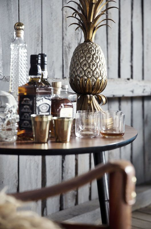 The bar corner in the livingroom loft at the Milla-farm in Aurskog. Home of interior stylist Camilla Berntsen. Vintage pineapple table lamp and brass shot glasses by Alexander Wang.