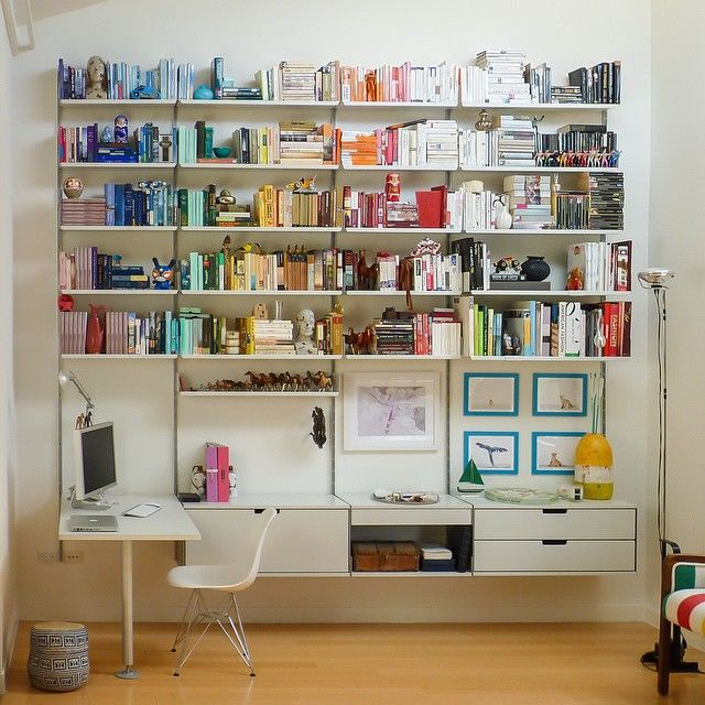 the 606 universal shelving system designed by dieter rams in photography by rob
