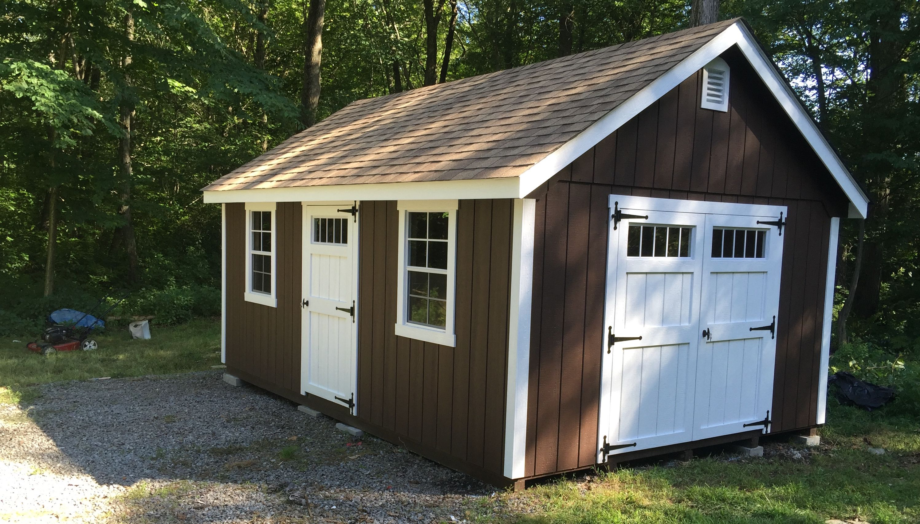 This Custom A Frame Storage Shed From Best In Backyards Of Ny And Ct Features Bright White Trim And Doors Against A Deep Brow Outdoor Sheds Backyard Sheds Shed