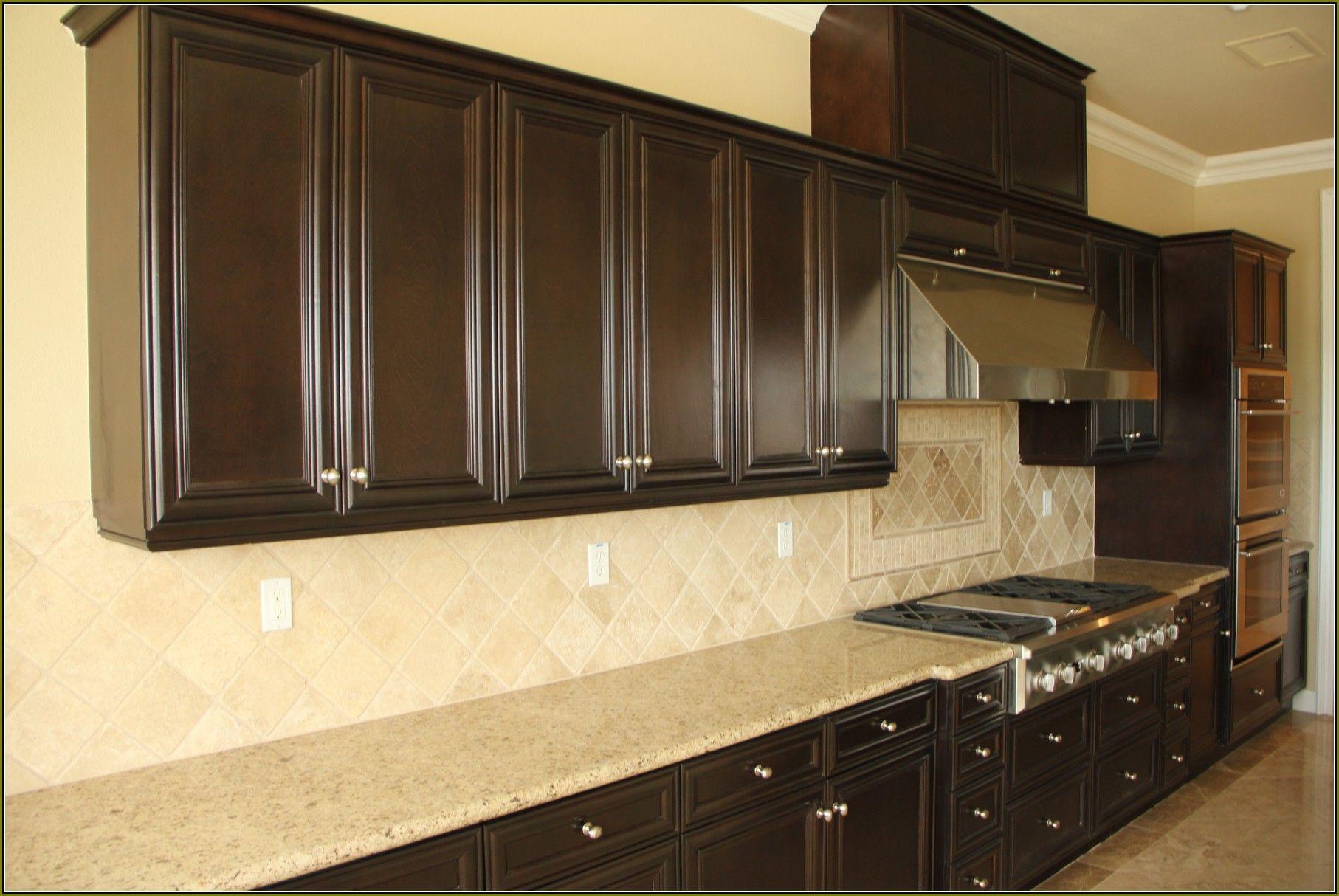 Dark Wood Island With Gold Hardware Dark Wood Kitchen Cabinets Dark Wood Kitchens Wood Kitchen Cabinets
