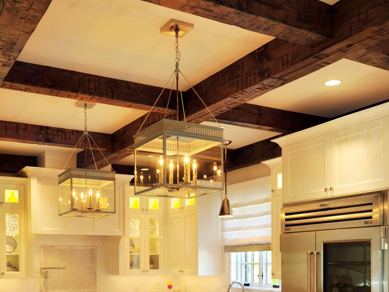 Exposed Dark Stained Wood Beams Create The Coffers In This