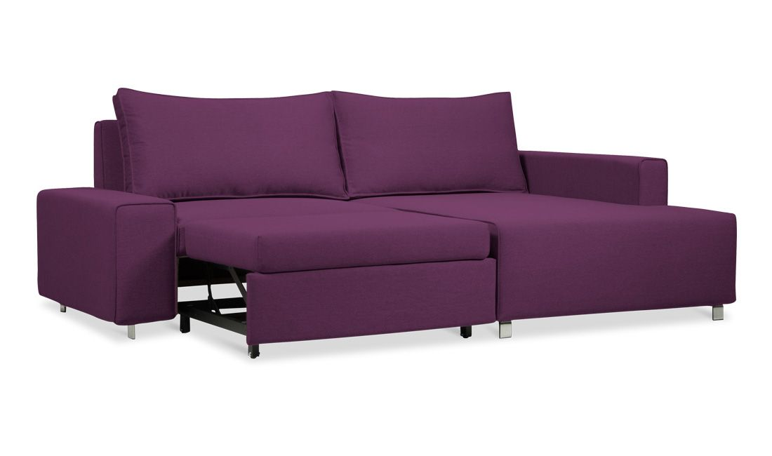 """Aubergine couch that converts into a double bed - not my color, but the idea is so much more inviting than a """"hide-a-bed"""""""