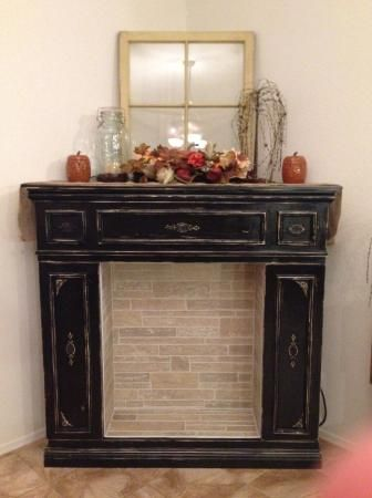 faux fireplace with hidden storage cabinets do it. Black Bedroom Furniture Sets. Home Design Ideas