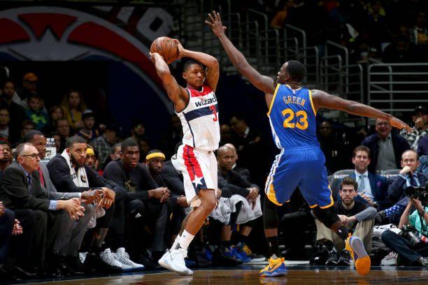 Bradley Beal of the Washington Wizards looks to pass the ball against the Golden State Warriors on February 28 2017 at Verizon Center in Washington...