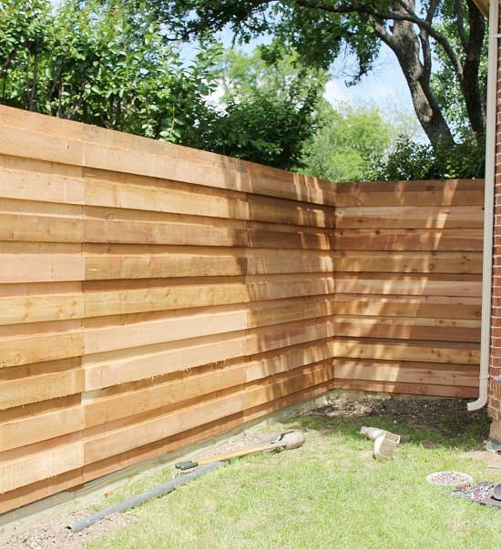 The backyard a new horizontal fence horizontal fence for High privacy fence ideas