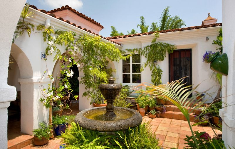 Stucco homes with shutters and wrought iron balcony for Spanish style homes for sale near me