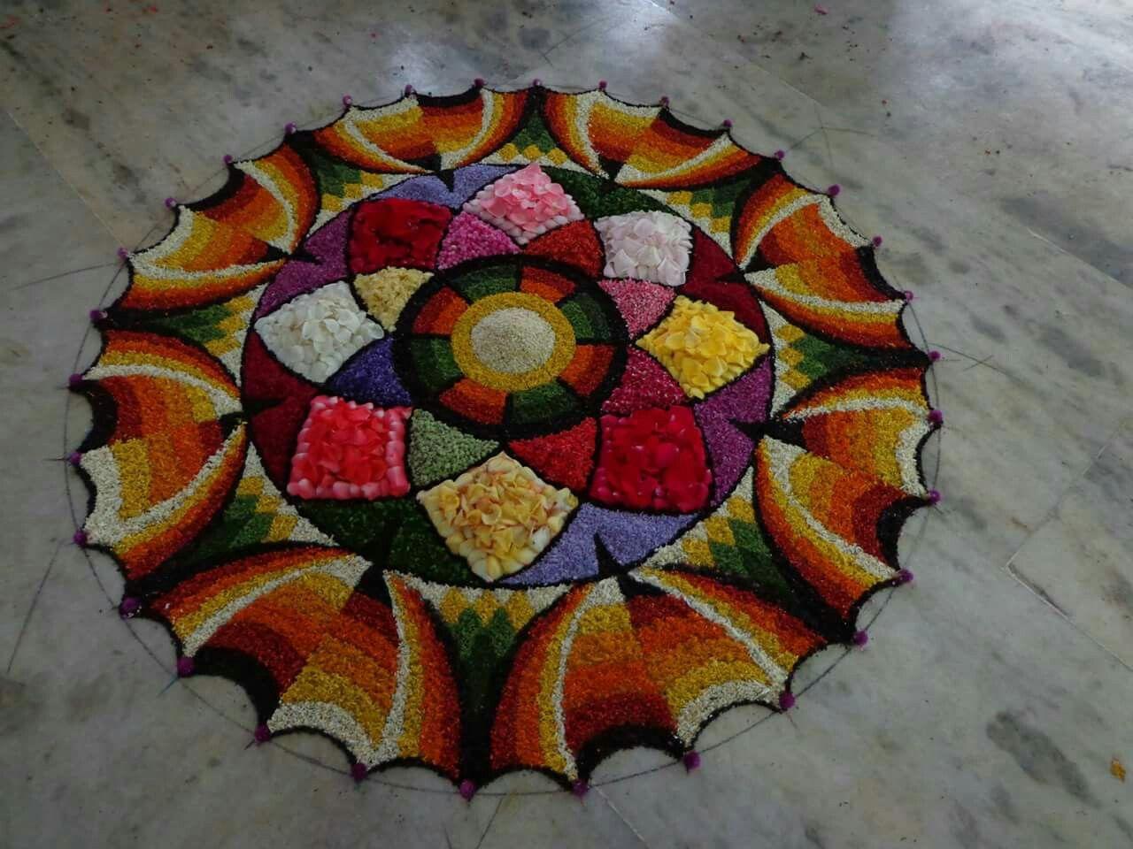Beutiful flower rangoli.... Flower rangoli, Rangoli colours