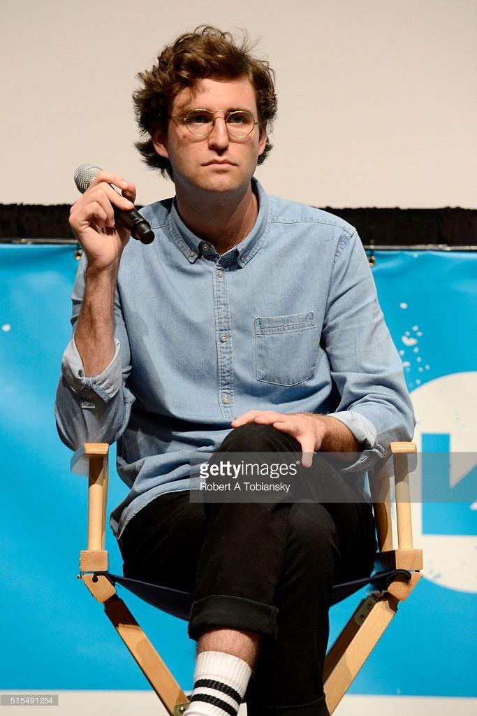 John Reynolds  stranger things actor face front glasses sitting front