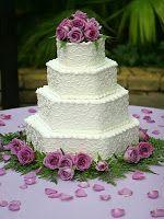 Lovely Hexagonal Non-fondant wedding cake. I love the white on white ...