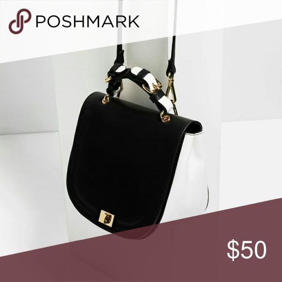 ZARA Oval Crossbody Bag Authentic Zara Oval Crossbody Bag in Black   White  (8703 104). Double sided buckle handle, detachable crossbody shoulder  strap, ... 18d773297b