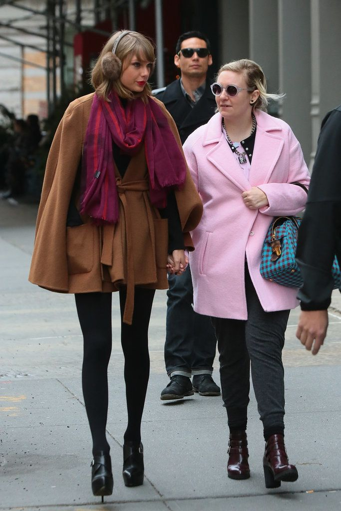We don't know what's cuter: Taylor holding hands with Lena Dunham or the singer's stylish brown cape.
