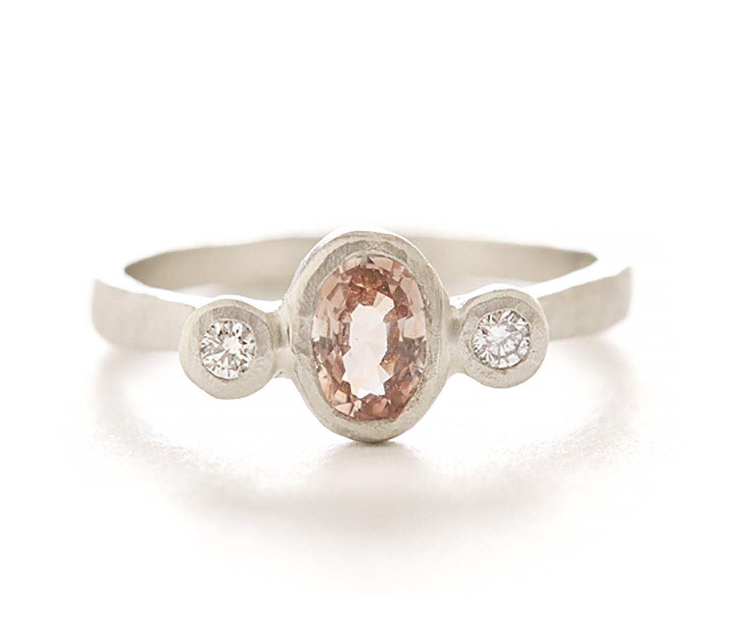 Hewn three stone oval padparadscha sapphire diamond ring