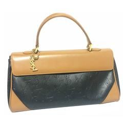 Vintage Yves Saint Laurent YSL logo embossed black leather handbag purse