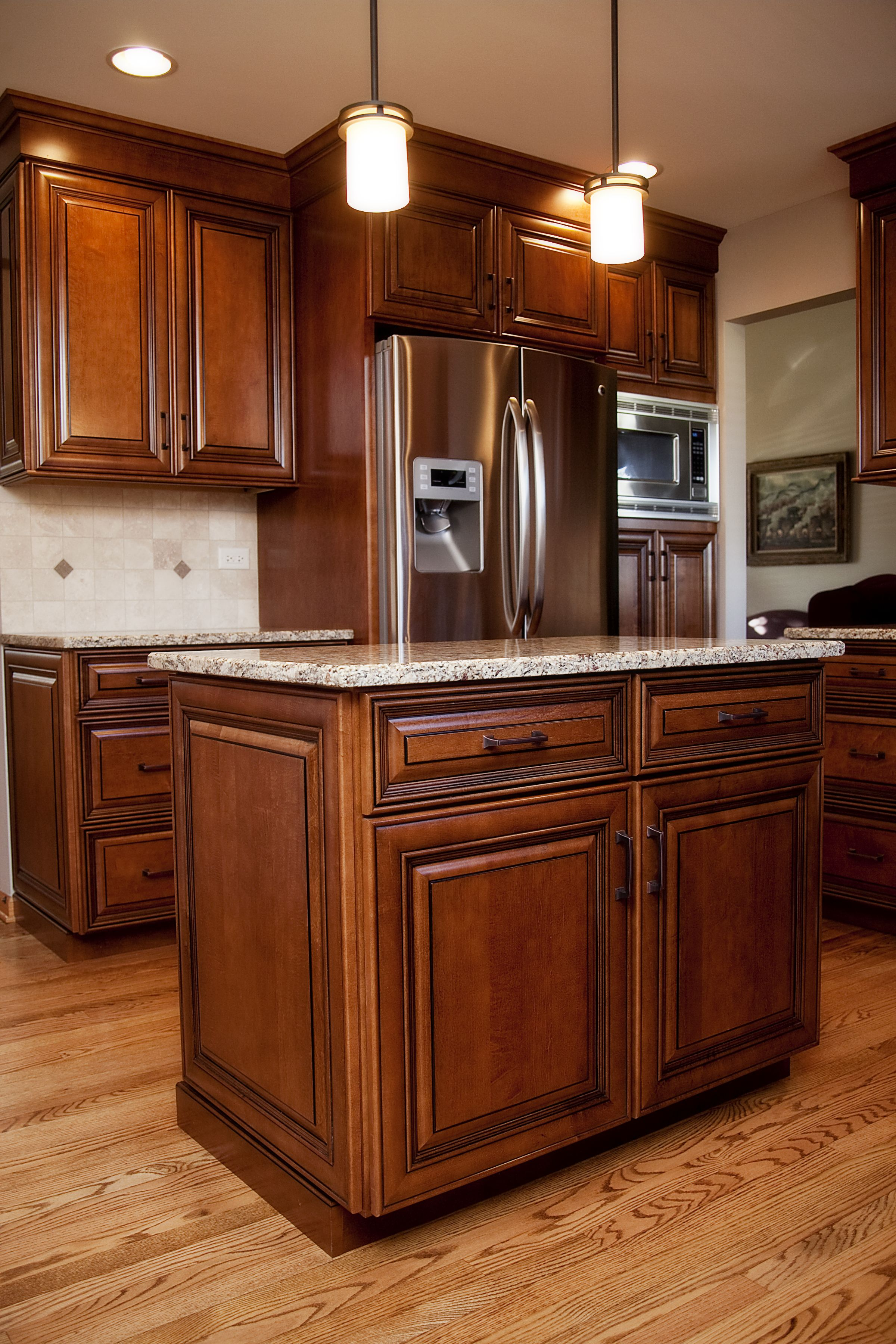Beautiful maple stained cabinets with black glaze in this Plainfield