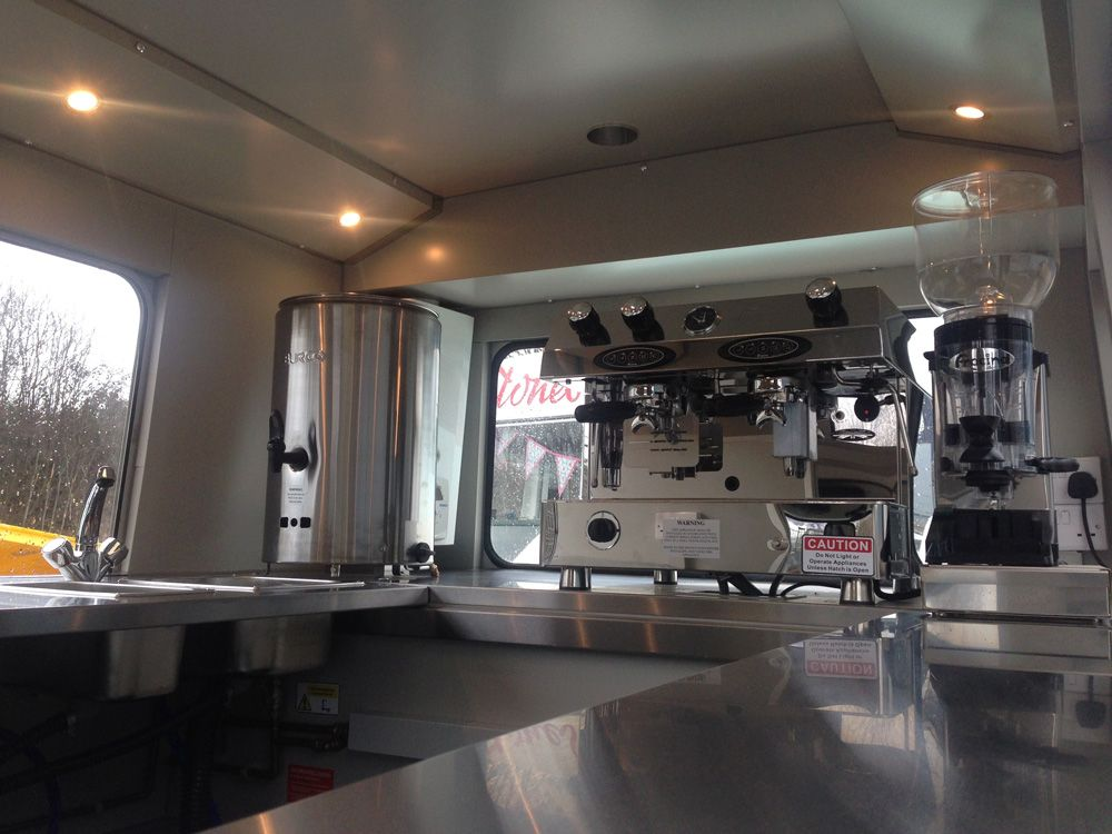 A Wood Burning Pizza Oven In Van Mirrored Walls Oak Worktops Fully Equipped Mobile Bar
