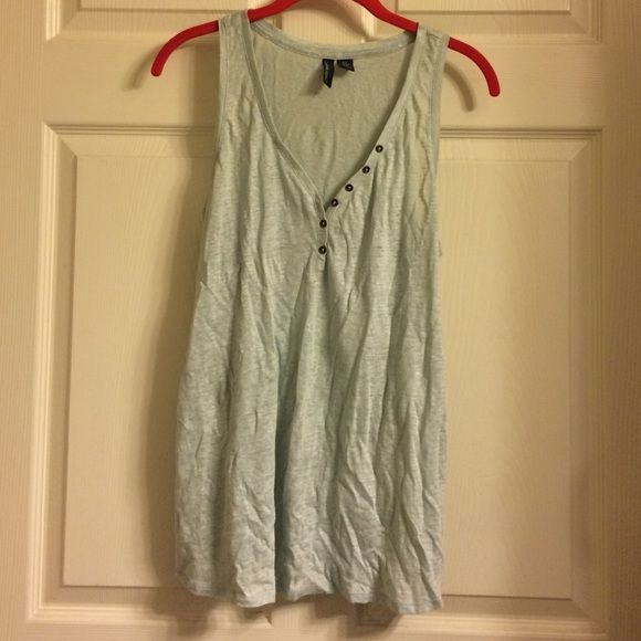 Baby Blue Top Baby blue tank top never worn. Very flowy and cute with any style! Wrinkled because it's been sitting in a bag in my closet but in GOOD condition! Never Worn!!! Tops Tank Tops