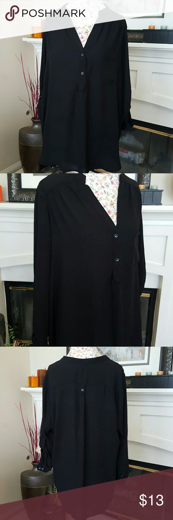 Black Blouse Beautiful Blouse! Can be worn oversized with leggings or skinny jeans. High low, sleeves can be rolled up or down. Small button on back and 2 buttons at chest with pocket. Tops Blouses