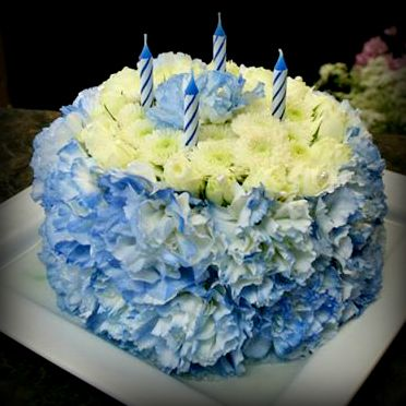A Blue And White Floral Birthday Cake Made With Carnations And Mums Created By Our Grower Direct Store In Sarni Cake Birthday Gift Ideas Fresh Flower Bouquets