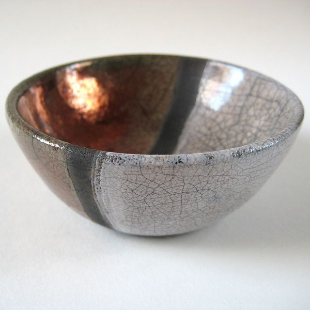 Raku bowl with a white crackle glaze and a copper/green crackle glaze by Jude Allman, a potter based on the Isle of Wight in the UK