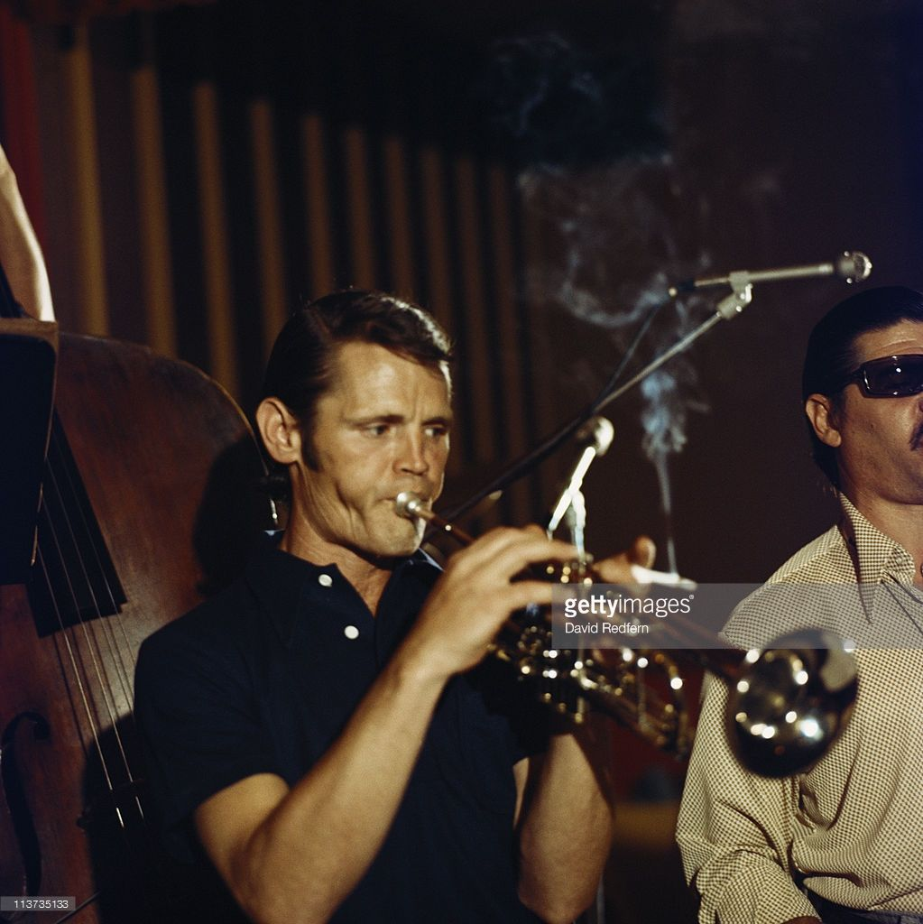 Chet Baker (1929-1988), U.S. jazz trumpeter, playing the trumpet during a live concert performance at the Blue Note club in New York City, New York, USA. in 1974. Baker is holding a lit cigarette while playing the trumpet