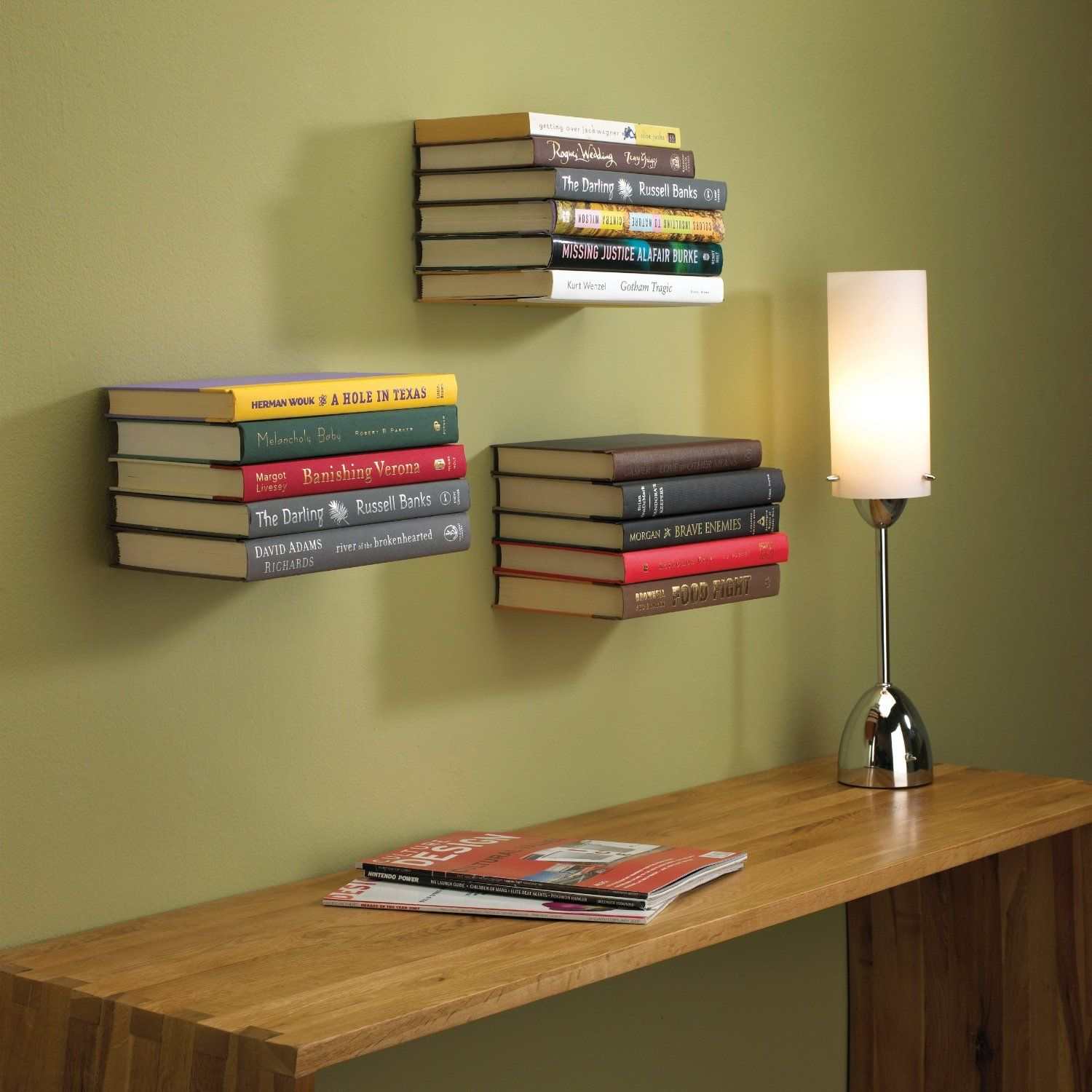 the invisible bookshelf vanishes behind a stack of books