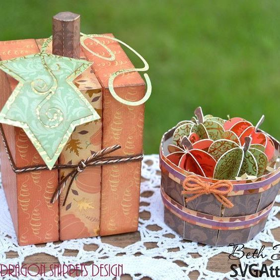Who is loving fall so far?  I am!  These are made from #svgattic files and papers from #dcwvinc I embellished with #trendytwine Details are on my blog. Link is in my profile. #bethsbeauties #dcwv #3d #pumpkin #apples #barrel #papercrafting #fall #autumn #svg