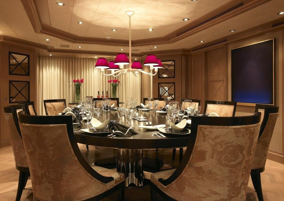 Elegant Round Dining Table Furniture With Beige Upholstered Chair And Dark  Wooden Design With Pink Ceiling