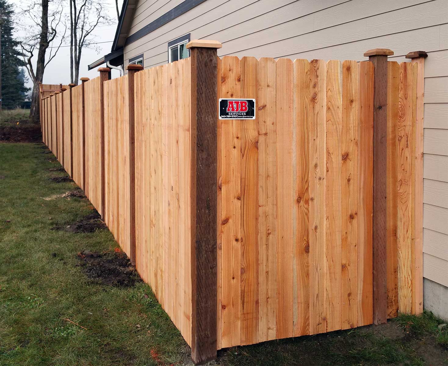 dog ear fences like this one in rochester provide cost effective