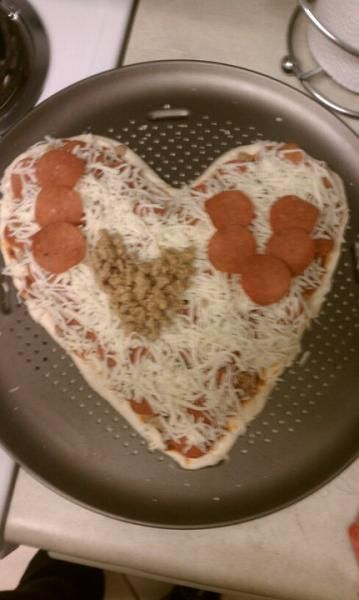 They always say the way to a man's heart is through is stomach... Valentine's day pizza