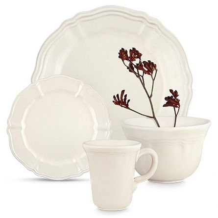 the scalloped detail on this set of 16 stoneware dinnerware pieces from the luisa collection was originally created for italian nobility, giving this