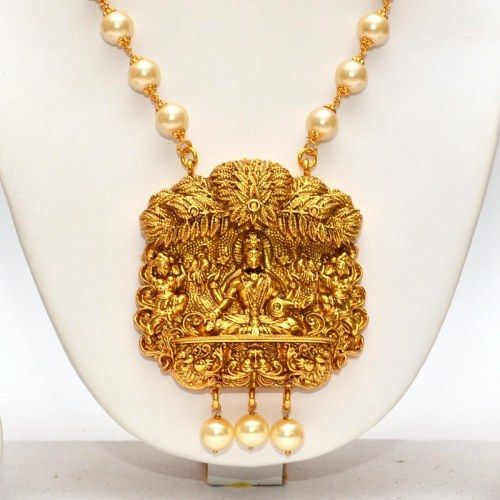 Anvi's lakshmi (temple jewellery) pendent with a pearl chain