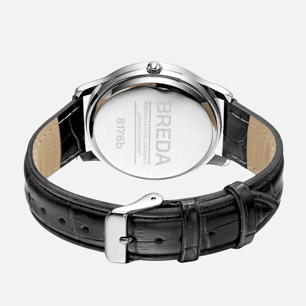 Thin silver bezel with a large silver dial, silver roman numerals, and silver hands. The faux crocodile grain brown leather band sits comfortably on the wrist. Beautiful, stylish, classy and with a certain status.