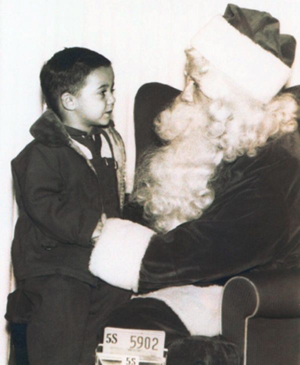 little Tommy visiting Santa Claus
