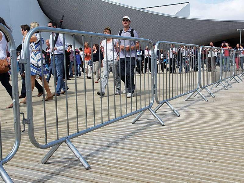 Visitors walk through a pedestrian passageway made up of