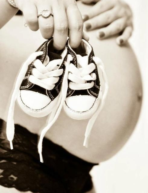 955bee8625bd1 too cute! little baby shoes with pregnant belly. Maternity photos ...