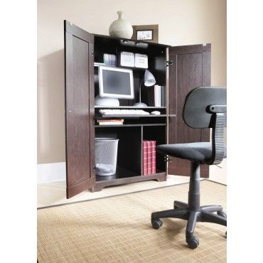Perfect for small spaces! Computer work station in which the doors can be closed when not in use.