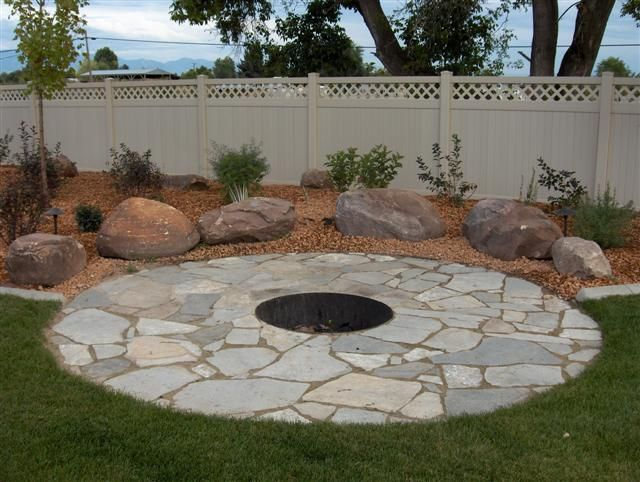 Flagstone · Flagstone firepit ... - Flagstone Firepit With Boulders. Boulders Could Be Used As Seating