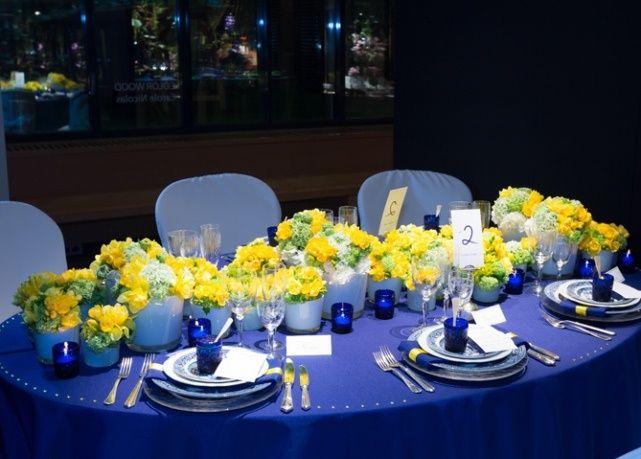 Cobalt Blue Tablecloth And Yellow Flower Arrangements