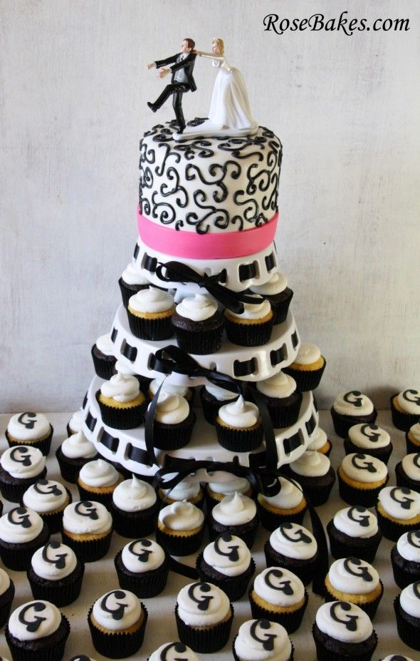 black and white cupcake tower with hot pink and scroll piping cake