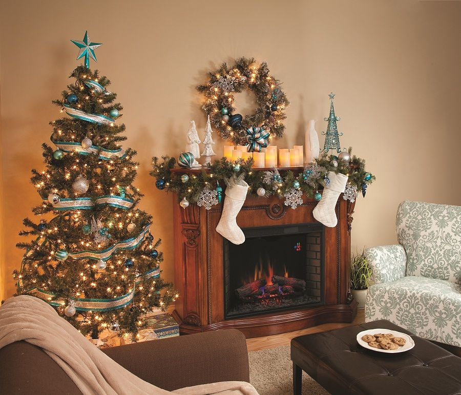 Decorating A Mantle With Snowflakes For Christmas Mantel