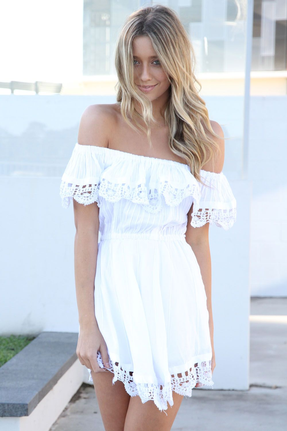 cute, white, boho dress!!! This is a fun alternative to a strapless dress, since there are technically sleeves to help keep the dress in place.