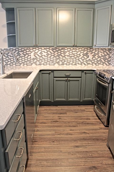 How perfect is kitchen! Its perfect for smaller kitchens that can outlook a dinning space or living room. Love the color contrast between floors, cabinets, and countertops. Countertops is Cambia in whitney with a glass mosaic back splash. Created and installed by Florida Bath & Surfaces