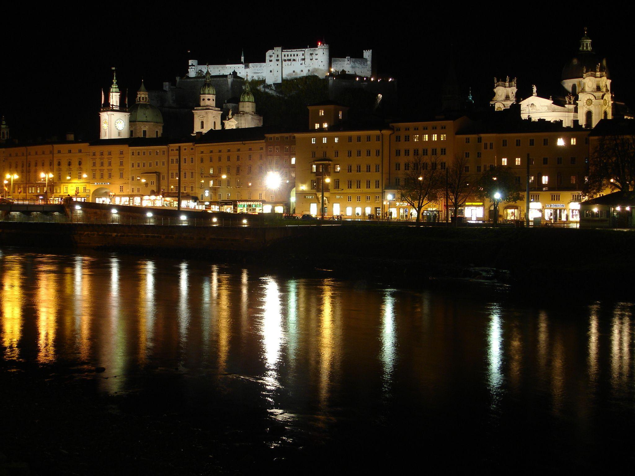 The fortress (background), Salzburg Cathedral (middle), River Salzach (foreground), Salzburg, Austria