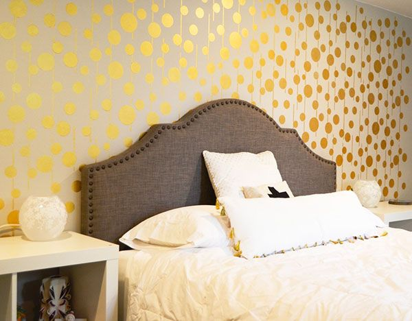 stenciled bedroom feature wall with pharaohs gold metallic paint uzma circles wall stencil by royal - Walls Paints Design