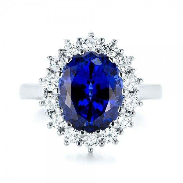 dd627d732 This dazzling engagement ring features a large oval blue sapphire prong set  in the center of a shared prong set diamond halo atop a platinum band, ...
