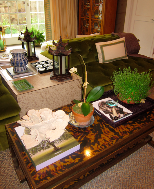 Tortiseshell Coffee Table And Emerald Tufted Sofas At The