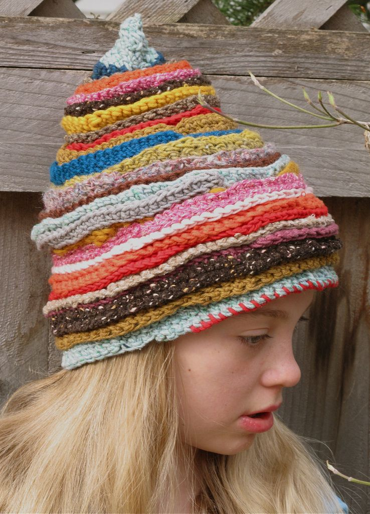 Knitted hat with scrap yarn.  ) I have all I need to try one of these! cdf0c0906fb