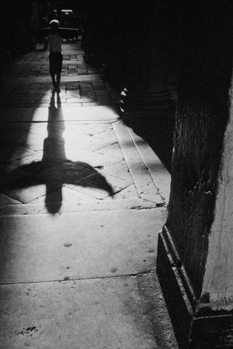Shadow of a child playing with his sweater near St Mark's Square, Venice, Italy by Jean Noël de Soye