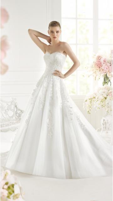 Robe de mariée en tulle applique sans manches traîne chapelle chic et moderne
